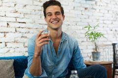 Handsome Man Smile Drink Cup of Coffee Stock Images
