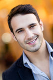 Handsome man smiling Stock Images