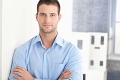 Handsome man smiling arms crossed Royalty Free Stock Photography