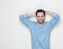 Handsome man smiling with hand in hair Stock Images