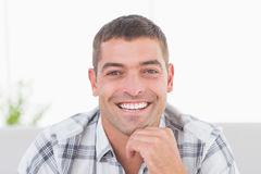 Handsome man smiling at home Royalty Free Stock Images