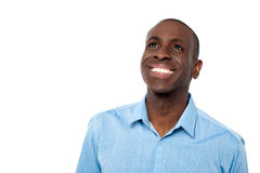 Handsome man smiling and looking away royalty free stock photos