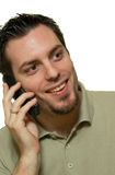 Handsome man smiling on the phone Stock Images