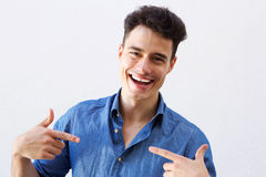 Handsome man smiling and point in fingers to himself Stock Photography