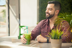Handsome man with a smoothie Royalty Free Stock Photos