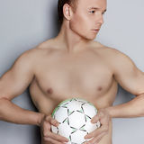 Handsome man with soccer ball Royalty Free Stock Image