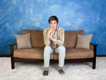 Handsome Man on Sofa Stock Images