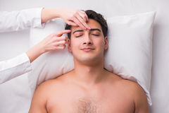 The handsome man in spa massage concept. Handsome man in spa massage concept royalty free stock images