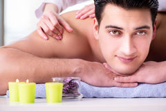 The handsome man in spa massage concept Stock Photo
