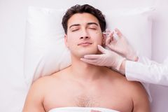 The handsome man in spa massage concept. Handsome man in spa massage concept Stock Photos