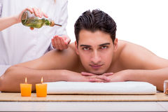 The handsome man during spa massaging session Royalty Free Stock Images