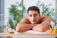 The handsome man during spa massaging session Royalty Free Stock Photo