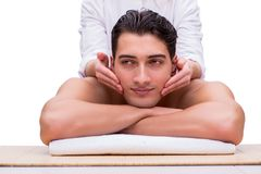 The handsome man during spa massaging session Stock Images