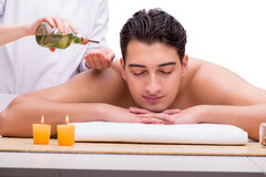 The handsome man during spa massaging session Royalty Free Stock Photography
