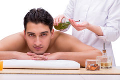 The handsome man during spa massaging session Royalty Free Stock Photos