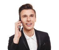Handsome man speak on mobile phone isolated at white Royalty Free Stock Photography