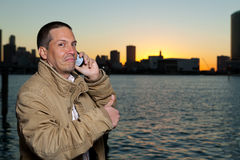 Handsome Man Speaking on a Mobile Phone Royalty Free Stock Images