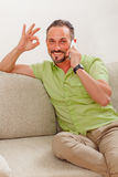 Handsome man speaking over phone Royalty Free Stock Photography