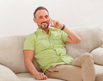 Handsome man speaking over phone Stock Image