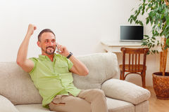 Handsome man speaking over phone Royalty Free Stock Photo