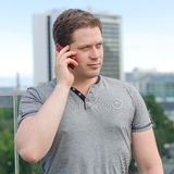 Handsome man speaking on the phone Royalty Free Stock Images