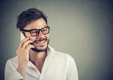 Handsome man speaking on the phone happily Stock Images