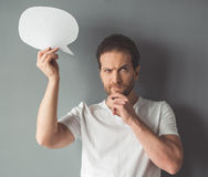 Handsome man with speech bubble Stock Photography