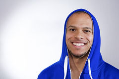 Handsome man in a sports hooded top smiling to camera Stock Image