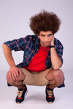 Handsome man squatting Royalty Free Stock Photography