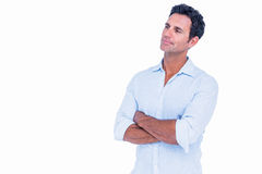 Handsome man standing with arms crossed Stock Photo