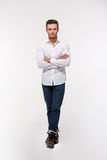 Handsome man standing with arms folded Royalty Free Stock Photography