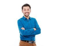 Handsome man standing with arms folded. Smiling handsome man standing with arms folded isolated on a white background stock photo