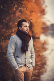 Handsome man standing in autumn park Stock Photo