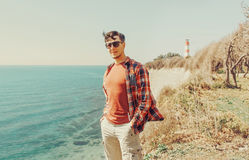 Handsome man standing on beach Stock Images