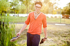Handsome man standing on a bridge by the lake Stock Photography
