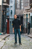 Handsome man standing on the downtown street. Royalty Free Stock Photography