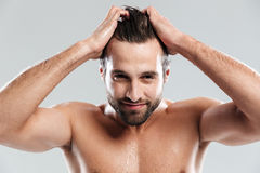 Handsome man standing isolated over grey background royalty free stock photography