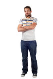 Handsome man standing isolated on white. With crossed arms Royalty Free Stock Images