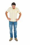 Handsome man standing and looking on the floor Stock Photo