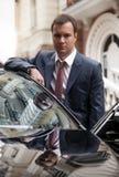 Handsome man standing near car Stock Photos