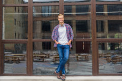 Handsome man standing outside of office building royalty free stock image