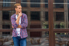 Handsome man standing outside of office building stock images