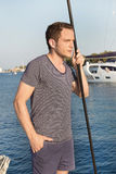 Handsome man standing on a sailing boat - sailing trip. Royalty Free Stock Photos