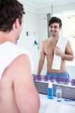 Handsome man standing with towel Stock Photos
