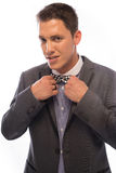 Handsome man straightening his bow tie Stock Images