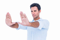 Handsome man stretching his arms Royalty Free Stock Photos