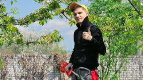 Handsome man with string lawn trimmer stock video