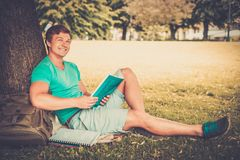 Handsome man student in a park Stock Image