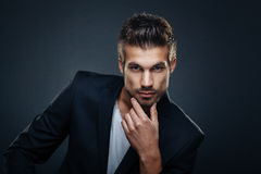Handsome man in a studio on a dark background Royalty Free Stock Photography
