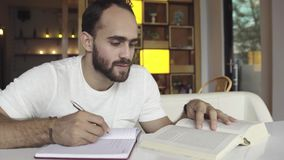 Man studying, preparing for exam Stock Photography